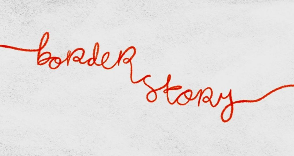 """""""borderstory"""" in cursive written with red crayon against a grey mottled background"""