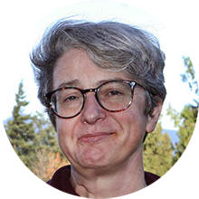 Outdoor portrait of Michelle Stack with trees in the background
